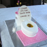 Toilet Cake Carrot cake with cream cheese icing covered in fondant - both tank and bowl. Toilet lid is white chocolate with RI writing. Vase, flowers,...