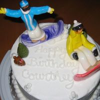 Snowboarder Figure Cake fondant figures snowboarders with bunny and pine trees . snowball decorations