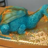 Blue Dragaon My co worked asked me to make a dragon cake for her son, she wanted it blue and orange... this is what I came up with... the dtragon in...