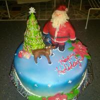 Santa And Rudolf Cake Santa and Christmas tree made of rice crispy treats covered in vanilla choc clay, rudolf made of choc modelling clay, the cake is Hershey&#...