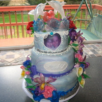 Dolphin Wedding Cake This cake is 3 tiers, the bottom tier is butter white cake alternated with marble (butter white and hershey's chocolate cake) the...
