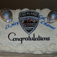 Retiring Police Officers Carrot Cake with Cream Cheese Frosting- Badges and Insignia are Painted Gum Paste.
