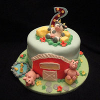 Fisher Price Farm Cake  Made for my son's second birthday. He loves Fisher Price farm stuff so I tried to replicate some of that in the cake. I haven't...