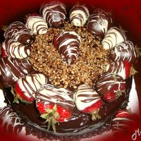 Triple Threat Chocolate Chocolate cake,ganache filling & covering & chocolate covered strawberries & pecan pieces