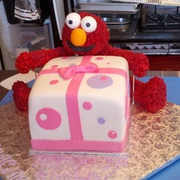 Elmo's Gift Elmo is made out of RKT with buttercreme using grass tip, this was delivered to chuck-e-cheese & they thought it was an actual stuffed...