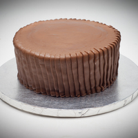 Reese's Peanut Butter Cup My attempt at a cake that tastes and looks like a Reese's Peanut Butter Cup, though it looks more like a Reese's Miniature. The...