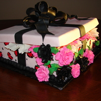 Leopard Print Birthday Present choc cake with cream cheese frosting and mmf lid and bow made with gum paste and fondant Gum Paste Roses and tissue paper Thanks for...