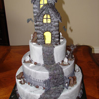 Halloween Haunted House thank you Pilla for the idea of this cake I was inspired by the one you did.this is actually a dummy cake that I used at a grand opening of...