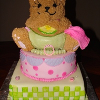 Precious Bear Pink Baby Shower Theme white cake with strawberry filling bear made from bear pan Im not happy with the bottom tier I wish I would of done it a little different...
