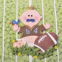 Football Baby!!! 12x18. Iced in buttercream fonandat accents. The score board is paper. When I went to have an edible image made, they couldn't do it...