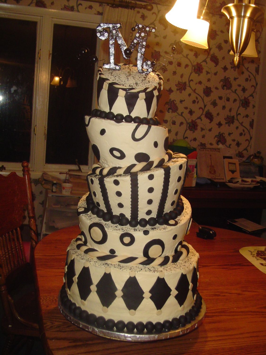 Black And Ivory Topsy Turvy Ivory buttercream, ivory and black fondant, topper was made out of foam core board