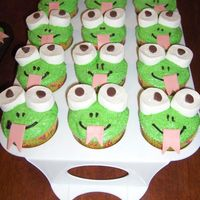 Frog Cupcakes   eyes made with big marshmellows cut in half. The pupils are chocolate chips pointy side down. The tounge is bubble tape bubble gum.