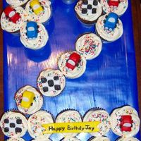 Car Cupcakes  *inspired by dabear's car cupcakes. These are chocolate/chocolate chip with whipped cream icing. The cars, flags and the banner is MM...