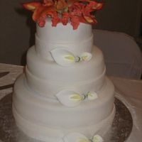 Calla Lilly Wedding Cake Believe it or not this is my first wedding cake. It is a rum soaked vanilla cake, with rum butter creme. I made the Calla Lillies and the...