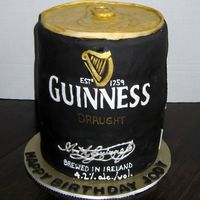 The Infamous Guiness Can  For a Guiness fanatic. I made the cake in May...he still has it. He wouldn't allow it to be cut. Says he's going to smuggle it to...