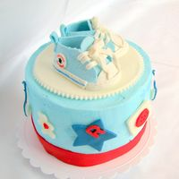 Top Cake With Baby Chucks For my friend's baby shower. Sat on top of the cupcake tower.