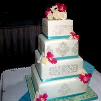Shimmery Damask Wedding   Fondant bamboo on board, gumpaste flowers to match the brides bouquet, shimmer airbrush stencil.