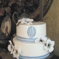 Dogwood Flowers Shower Cake Gumpaste dogwood flowers made without wires. Blue fondant accents lustered with Super Pearl. Swiss meringue buttercream.