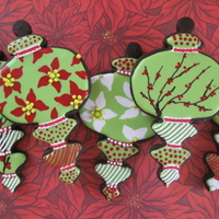Christmas Ornament Cookies I am getting started early this year on Christmas cookies! Poinsettas and berry branches were done wet one wet as were most of the dots....