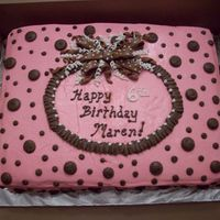 Pink With Polka Dots Marble cake with bavarian cream filling and buttercream frosting and decorations. Bow is a combination of fondant and buttercream.