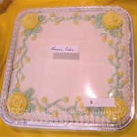 Simple Roses   I was just having fun for a bake sale. This is a lemon cake covered in lemon bc with royal icing roses.