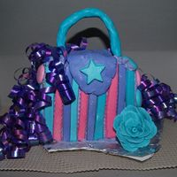 Purse Cake For A 2 Year Old Cream cheese icing with candy mold accents