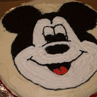P5035845.jpg Mickey Mouse cake...cream cheese icing with crushed oreos.