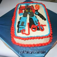 Transformers Birthday Cake Chocolate cake (Hershey's version), Bavarian cream filling, vanilla buttercream frosting. Made design using rice paper transfer of...