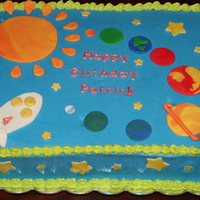 Out Of This World Cake MMF decorations with buttercream frosting