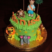 Diego Safari Cakes And Cupcakes  Individual Safari cake with gumpaste animals for birthday boy. Cupcakes with gumpaste cutouts for party guests. Giraffe and Lion on...
