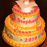 Graduation Cake  Made to match invitations. Strawberry cake on top; marble on bottom with cheesecake filling and white chocolate buttercream. Cap and all...