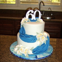 60Th Anniversary Cake   Lemon wasc with lemon mousse swirled with lemon curd....how lemony! Fondant with gumpaste accents.