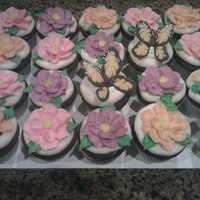 Springtime Cupcakes   WASC chocolate cupcakes with rum custard filling, buttercream icing and chocolate butterflies.