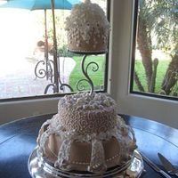 My First Wedding Cake   This cake was done for a very good friend of mine, fondant, with royal, fondant and gumpaste decorations and white chocolate shells. TFL