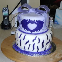 Clandestine Industries Cake This cake was made for my sister who is a HUGE pete wentz/fall out boy fan. The bat on the top cake is the logo from the clothing line pete...