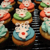 Reindeer Cupcakes Got the idea from wrapping paper. Reindeer made of Royal Icing. Thanks for looking!
