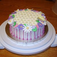 Flower Cake With Butterfly  One of the first cakes T made outside of the wilton class. Its Buttercream cake with royal icing flowers and a basket weave on top. There...