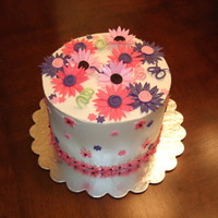 "Pink Daisy Cake 8"" round with butter cream. Fondant pink & purple daisies."