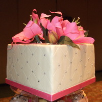 "Pink Lily Cake 8"" square cake, white chocolate panels over butter cream. Pink gumpaste lilies - my first time! Thank goodness for Edna's video!..."