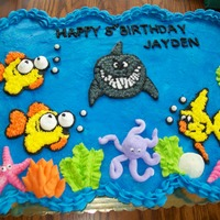 Jayden's 5Th Birthday Cake cupcake cake made with 40 cupcakes. Yellow cake filled with Ganache. Buttercream frosting. did outlines for fish as frozen Buttercream...