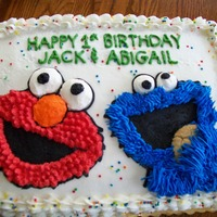 Elmo And Cookie Monster For twins first birthday.