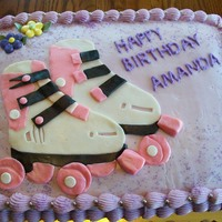 Rollar Skating Anyone Made for a co-workers birthday, cake was carrot with cream cheese frosting, skates done in fondant, sprayed with pearl luster