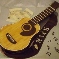 Guitar Cake My first attempt at a guitar cake for a friend's boyfriend. She sent me a picture of a real guitar and then I found several guitar...