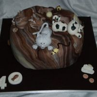 Cat Surprise A surprise birthday cake for a cat lover, a twist on the Debbie Brown Design.The birthday girl wanted to keep the cats, so they were...