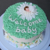 Daisy Baby Coconut cake with pineapple and coconut filling. Buttercream icing, fondants accents.