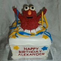 Elmo Cake This cake was such disaster! Original idea from Sugarshack, thanks. BUT... I could not make corners straight, lid would not fit (originaly...