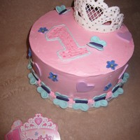 1St Birsthday I was trying to match the invitation. Buttercream with fondant accents, royal icing tiara.