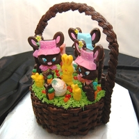 Easter Basket Cake   This was a fun cake to make. The handle is chocolate. The bunnies are poured chocolate with fondant accents. The grass is royal icing.