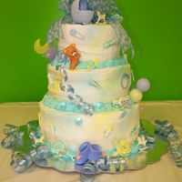 Oh Baby Boy  This is a 3 tiered baby shower cake for a Baby Boy. It consisted of three different flavors, chocolate, vanilla and strawberry cake....