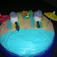 Geese Laying On The Beach The geese are fondant that I shaped into geese. The cake is covered in frosting and the sand is crushed Nila Wafer cookies. The beach...